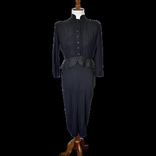 Vintage 1950s black peplum dress