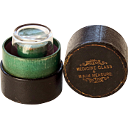 Medicine Glass & Minim Measure in dark green leather covered box
