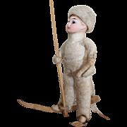Antique German Bisque Headed Glass Eyed Cotton Batting Christmas Skier Ornament, circa 1900