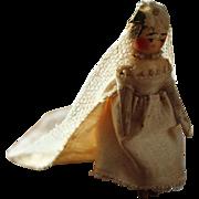 An Antique Grodnertal Peg Doll Bride