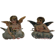 Two Lithographed Cherub Christmas Tree Candle Clips, circa 1910