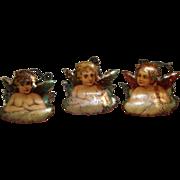 Three Lithographed Cherub Christmas Tree Candle Clips, circa 1910