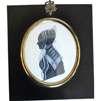 A 19th Century  English Oval Silhouette Of A Young Lady