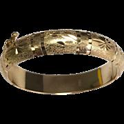 18 K Yellow Gold Etched Hinged Baby Bangle Bracelet
