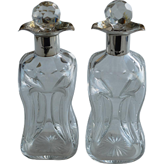 A Pair of 19th C. Liquor Decanters with Silver Top, London 1899