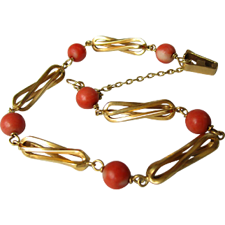 18K gold bracelet with round coral beads.