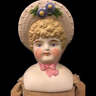 Antique German hatted bisque doll