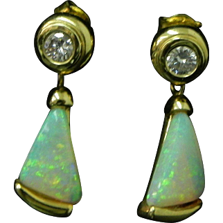 Opal and Diamond Earrings set in 14K gold. Incredible Fire Bookmatched cut from single Opal