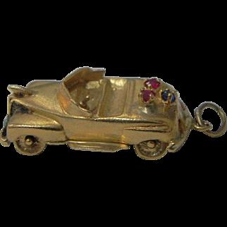 Vintage 14 karat Gold Charm for bracelet Convertible Automobile with moving wheels.