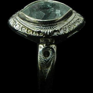 Woman vintage 14 karat white gold ring with unidentified  cut stone. Circa 1920s