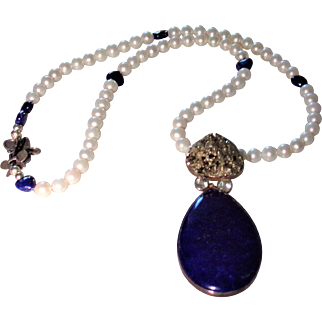 A Necklace featuring a large Lapis and Pyrite  Pendant with Cultured Fresh Water Pearls