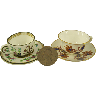 Two Miniature Cups with Saucers