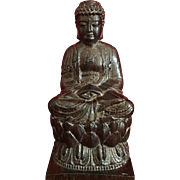 Buddha, carved in lotus position