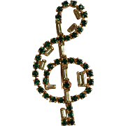 Huge vintage signed Pierre emerald green & light yellow-green rhinestone figural sol key note brooch pin