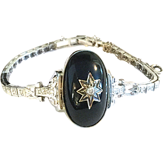 Antique 14k gold, black Onyx and diamond tennis bracelet.