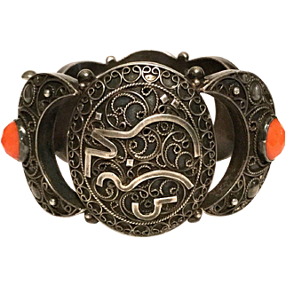 Antique silver Middle Eastern bracelet decorated with real coral.