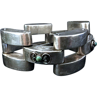 Vintage Mexican Mexico Arts & Crafts sterling silver bracelet decorated with turquoise.