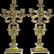 Pair of Renaissance Revival Figurative Bronze Candelabra
