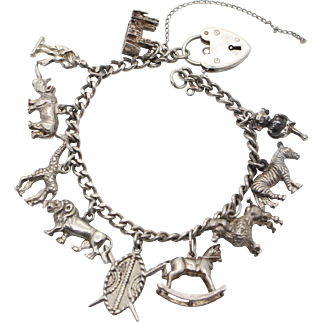 Hallmarked Sterling Silver 1970s Charm Bracelet with 10 Charms and Heart Faux Padlock Opening