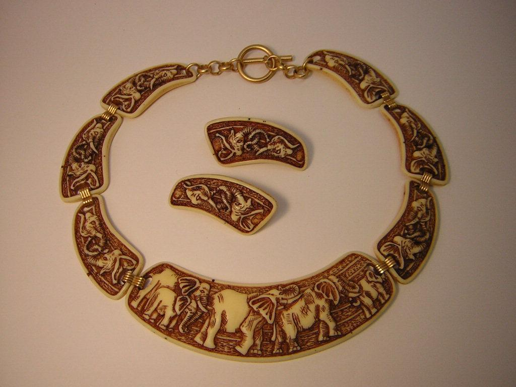 Vintage Faux Ivory Elephant Necklace And Earrings From
