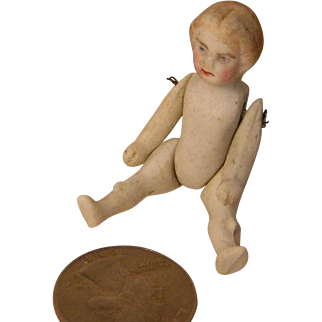 Tiny Bisque Doll