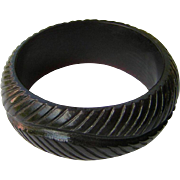 Dark Carved Plastic Bangle Bracelet