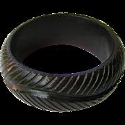 Dark Carved Plastic Bangle Bracelet