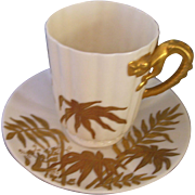 """Elegant, Dainty Belleek Chocolate Cup and Saucer; Decorated with a Lavish, Raised Paste, Gilded Fern Decor; Gilded Dragon Handle; Signed """"E.M.S. 1898"""""""