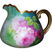 "Very Rare Limoges Cider Pitcher; Ruffled Rim; Gold Handle; Reflecting Roses in Shades of Pink; Signed ""A. Bronssillon"""