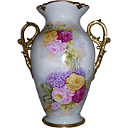 "Tressemann & Vogt Limoges Vase with Large, Scrolled and Gilded Handles Decorated in the Roses and Lilac Pattern; Artist Signed ""Rousset"""