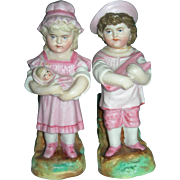 """4 3/4"""" Tall Brother & Sister Vases with toys"""