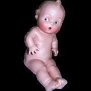 """Gebruder Heubach Grumpy/Surprised Baby Figurine ca. 1910, 5 1/4"""" tall"""