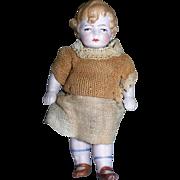 """3 5/8"""" Tall Grumpy Boy All Bisque doll"""