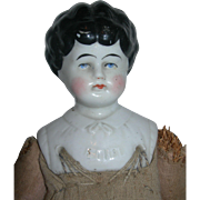 Ethel China Head on Strange jointed straw stuffed body