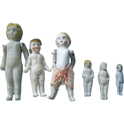 Six Tiny Stone Bisque Dolls