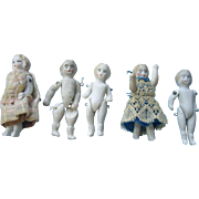 Five Jointed Stone Bisque Dolls