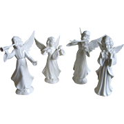Four Miniature German Angel Figurines