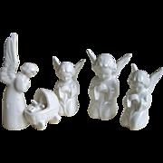 Four Miniature German Angel Figurines
