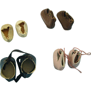 Four Pairs of Tiny Shoes