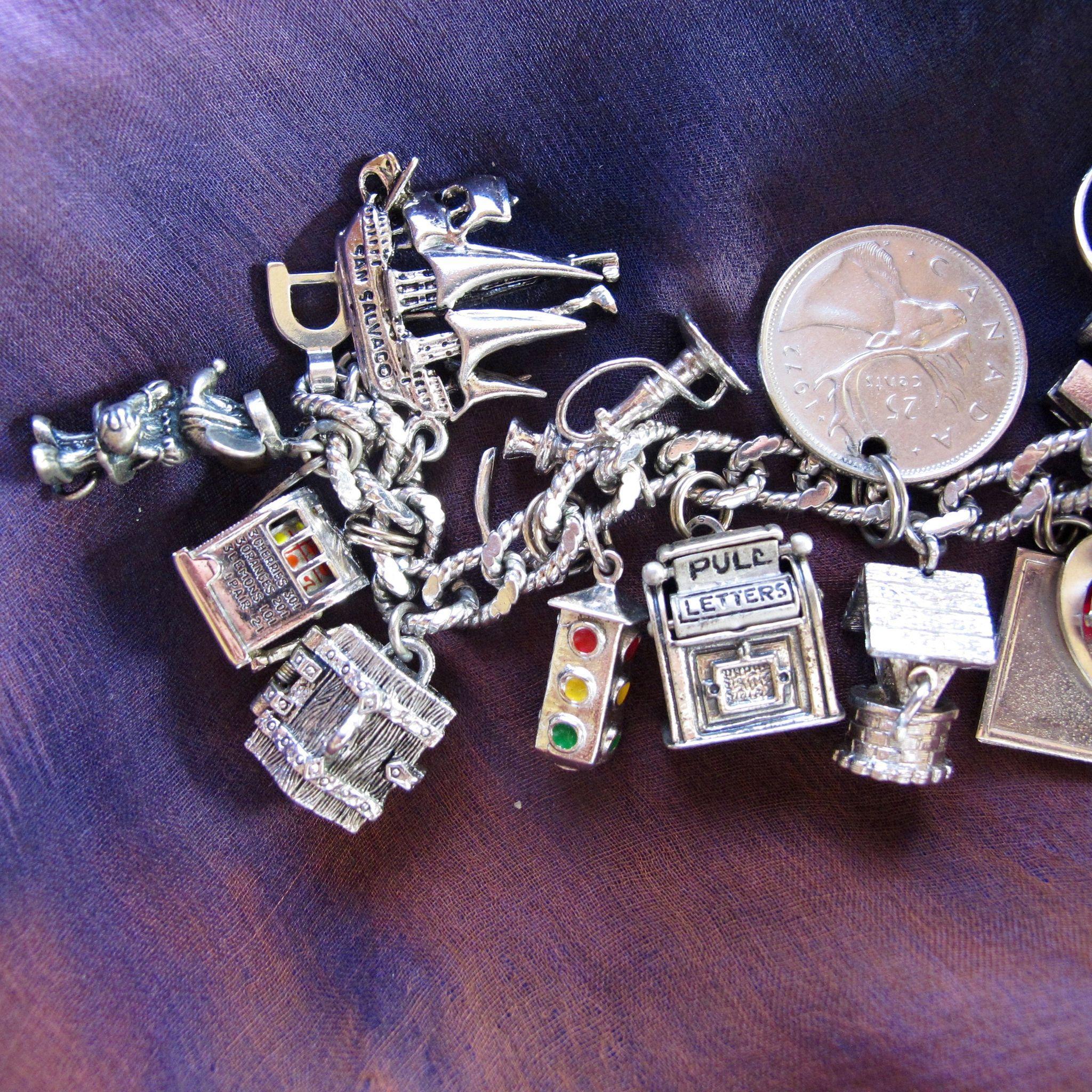 Vintage Monet Silver Tone Loaded Charm Bracelet Many Sterling