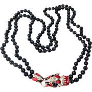 Vintage Black Beaded Necklace with Red, Black, and White Enamel Jaguar Head with Rhinestone Enhancements