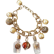 Vintage Charm Bracelet with Clear Bottles and Faux Pearls