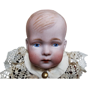 Unique all bisque boy doll, marked with a heart 425 over 23, made in Germany