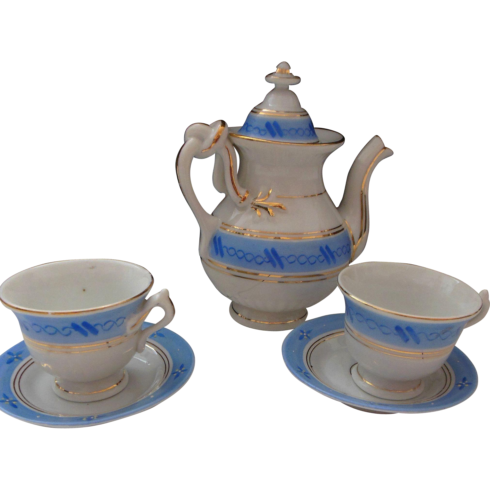 Doll size tea set with pot and 2 cups and saucers