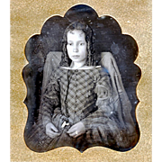 Hand-coloured Daguerreotype of Seated Girl with Cord Guard Chain & Watch at the Waist, mid-19th Century