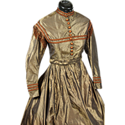 Bronze Lustre two piece Crinoline Gown with piping and fringe decoration, c1860