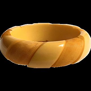 Bakelite Bangle Bracelet in a Pinwheel Carved Design