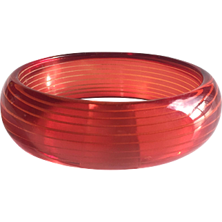 Bakelite Bangle Bracelet Reverse Carved in Raspberry