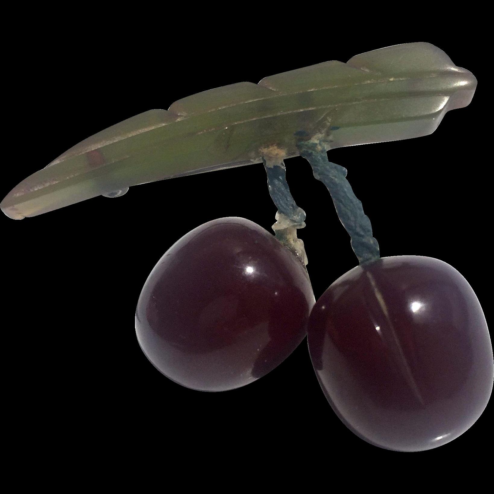 Bakelite Carved Cherries on a Bakelite Green Leaf Brooch
