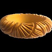 Bakelite Bangle Bracelet Carved in a Flower and Fan Pattern